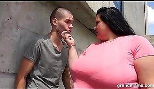 Obese grandma deepthroats young boy outdoors