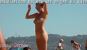 Hot blonde exhibitionist teen showing shaved pussy on the public beach!