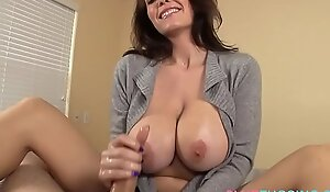 Busty MILF tugging cock and chatting dirty